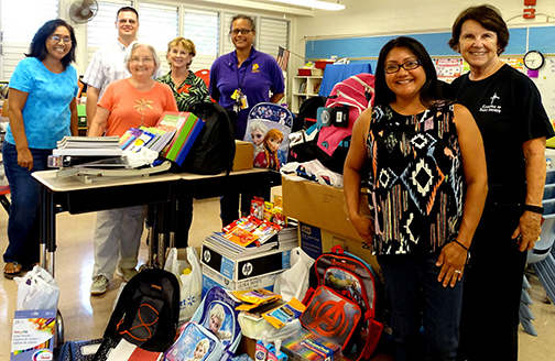 Delivering collected school supplies to the school