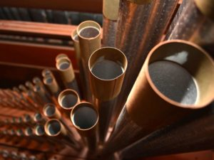 closeup photo: a few of the 4,500+ pipes in the Æolian-Skinner pipe organ in Honolulu, Hawaii.