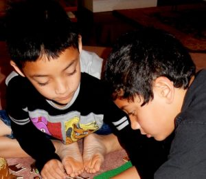 photo: two boys engaged in Godly Play Work