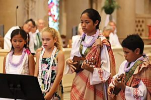 photo: children performing a song in church