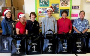 photo: ministry volunteers with bags of meat products for donation